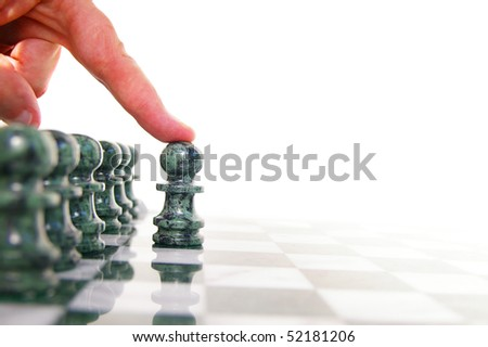 Chess piece moving forward on the board - stock photo