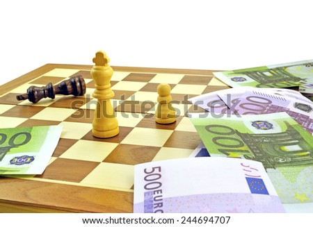 Chess pieces and euro money. Struggle and competition for money - stock photo