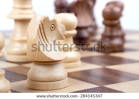 Chess pieces during on a chessboard. - stock photo