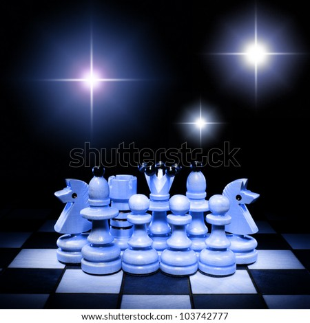 Chess pieces on a beautiful art background. - stock photo