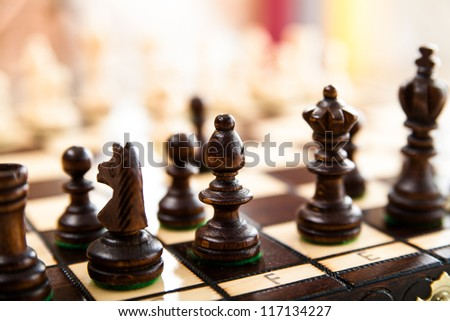 Chess pieces on a board - stock photo