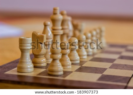 chess pieces on a table in the room, wood Chess Set - stock photo