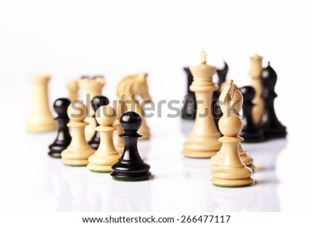 chess pieces on a white table - stock photo