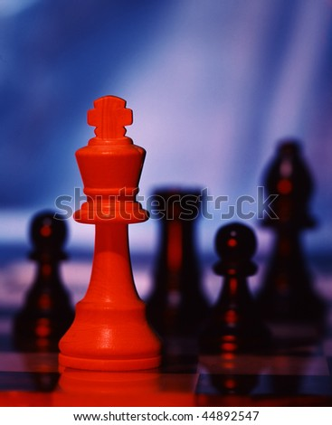 Chess pieces on board to show business competition - stock photo