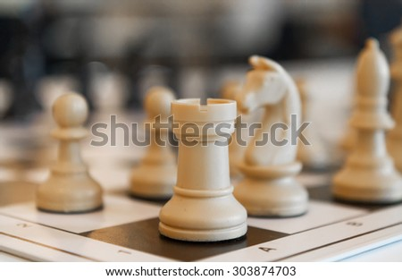 Chess pieces on the board close up - stock photo