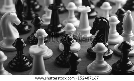 chess pieces on wooden table - stock photo