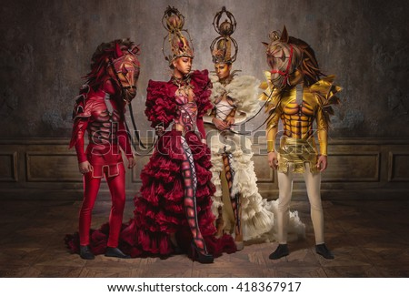 Chess queens with men in horse masks  - stock photo