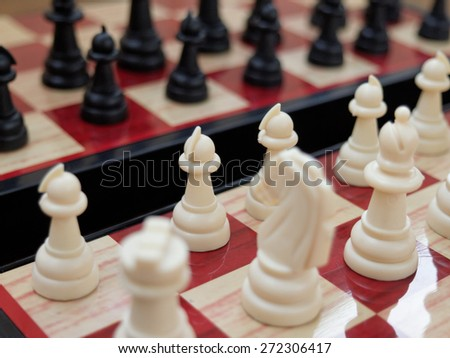 Chess: white against black / partially out of focus, focus on center, white pawns    - stock photo