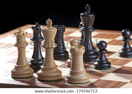 Chess - white and black kings with pawns - stock photo