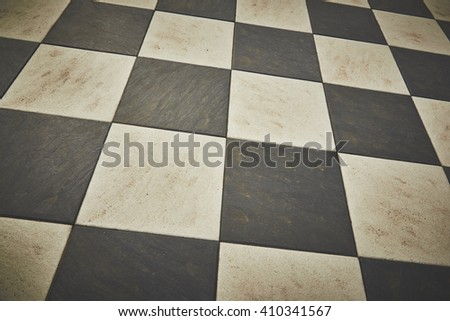 Chessboard pattern of a sidewalk. - stock photo