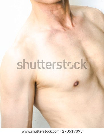 Chest and shoulder of Asian man - stock photo