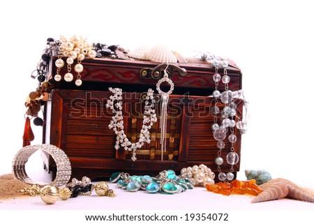 Chest full of jewelry - stock photo
