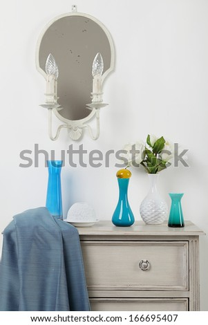 Chest of drawers with vases on top  - stock photo