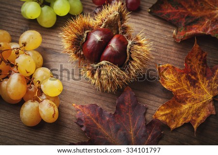 chestnut and grapes - stock photo
