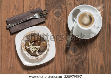 chestnut cake decorated with white chocolate and cup of coffee on wooden table - stock photo