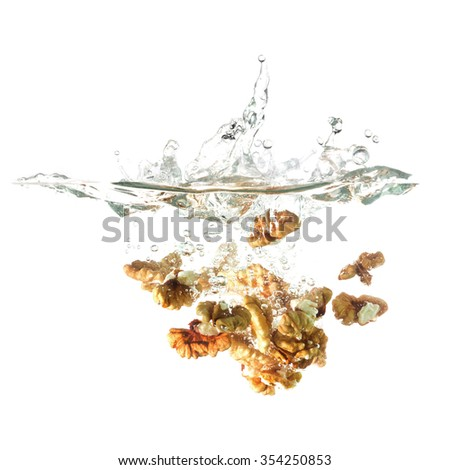 Chestnut splash on water, isolated on white background. Use for advertising raw food or fresh drinks. - stock photo
