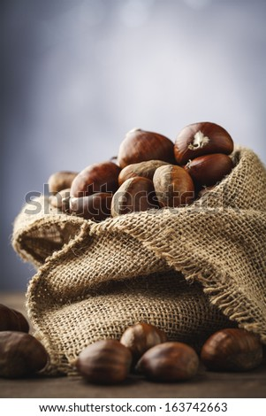 chestnuts in jute - stock photo
