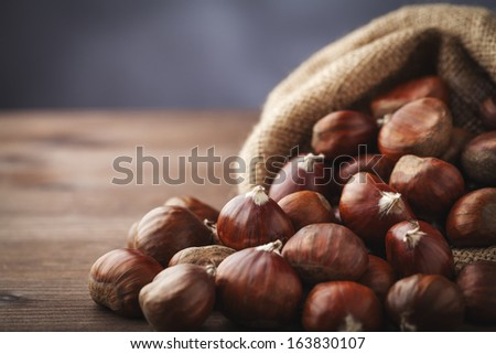 chestnuts in yute - stock photo