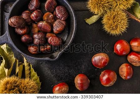Chestnuts, maroni - roasted chestnuts  - stock photo