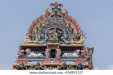 Chettinad, India - October 17, 2013:Detail of the Shiva temple gopuram at Kottaiyur shows Devi Saraswati playing the Veena with dancers and singers. Plenty of colorful statues. - stock photo