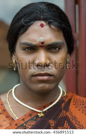 Chettinad, India - October 17, 2013: Ms. Abinaja, Hijra, transgender person, a male that dresses and acts like a woman, and has a sacred status in Hinduism. Dark, stern face and jewelry. Karaikudi. - stock photo