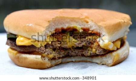 chewed cheese burger - stock photo