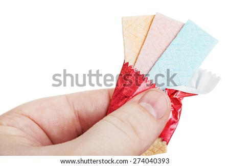 chewing gum in hand isolated on white background. focus on chewing gum - stock photo