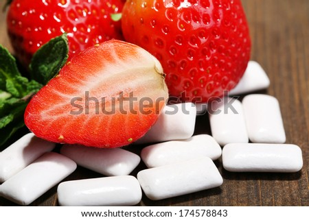 Chewing gums with fruit taste,   on color wooden background - stock photo