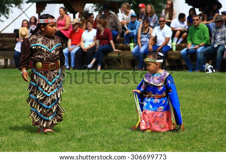 CHEYENNE, WYOMING - July 25, 2015 - Young Native American girls performing at a pow-wow - stock photo