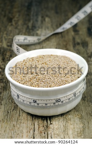 Chia seeds in bowl with measuring tape: healthy weight loss - stock photo