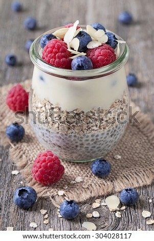 Chia seeds pudding with  blueberries and raspberries - stock photo