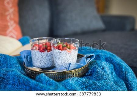 Chia seeds pudding with fresh strawberries and lemon balm. Selective focus. - stock photo