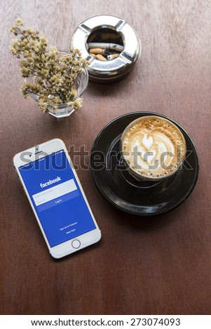 CHIANG MAI, THAILAND - APRIL 22, 2015: Facebook application using Apple iPhone 6. Facebook is largest and most popular social networking site in the world. - stock photo