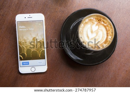 CHIANG MAI, THAILAND - APRIL 22, 2015: Log in page Twitter application using Apple iPhone 6 in coffee shop. Twitter is largest and most popular social networking site in the world. - stock photo