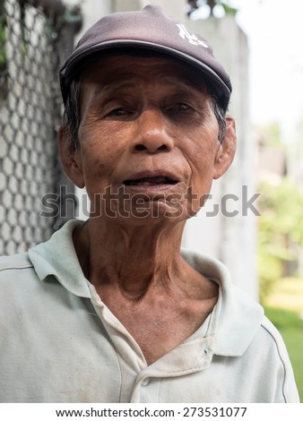 CHIANG MAI, THAILAND - APRIL 13 2015: Old man celebrates Songkran (Thai New Year Celebration). The annual water festival in Chiang Mai City, Northern Thailand. - stock photo