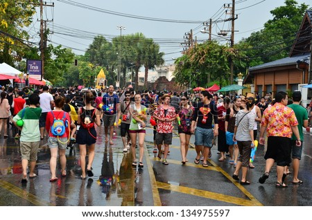 CHIANG MAI, THAILAND - APRIL 13 : People celebrating Songkran (Thai new year / water festival) in the streets by throwing water at each other on 13 April 2013 in Chiang Mai, Thailand - stock photo