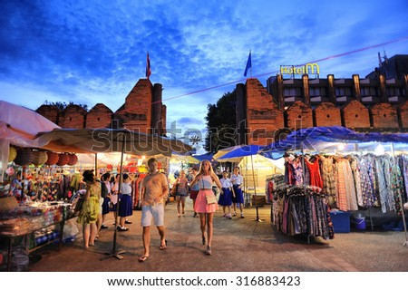 Chiang Mai Thailand - August 27 , 2015 : Tha-Pae Gate multi courtyard of the city often has night markets. There are souvenirs for sale, food and beverage store sales to tourists. - stock photo