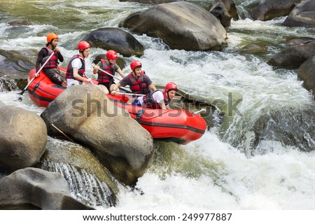 CHIANG MAI, THAILAND - FEBRUARY 3 : White water rafting on the rapids of river Maetang on FEBRUARY 3, 2015 in Chiang Mai, Thailand.  Maetang river is one of the most dangerous rivers of Thailand. - stock photo