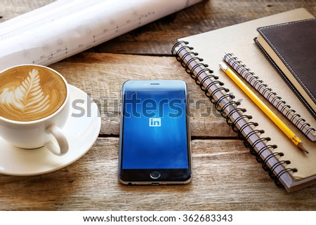 CHIANG MAI,THAILAND - JAN 15,2016: iPhone 6 plus with social network service LinkedIn on the screen. iPhone 6 plus was created and developed by the Apple inc. - stock photo