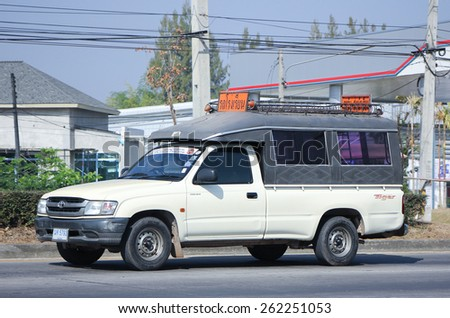 CHIANG MAI, THAILAND - JANUARY  5 2015: School bus. Pick up of Sansai Vithayakom School. Photo at road no 1001 about 8 km from downtown Chiangmai, thailand. - stock photo