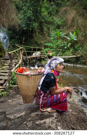 CHIANG MAI, THAILAND - JUL 25 : Karen hill tribe in forest with traditional clothes on July 25, 2015 in Chiang Mai, Thailand. - stock photo