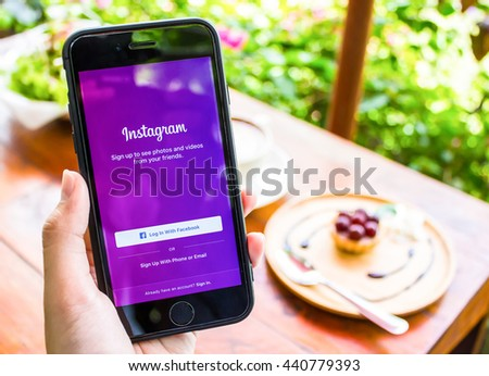 CHIANG MAI, THAILAND - JUN 17,2016: A women holds Apple iPhone 6S  with Instagram application 3D Touch on the screen. Instagram is a photo-sharing app for smartphones. - stock photo