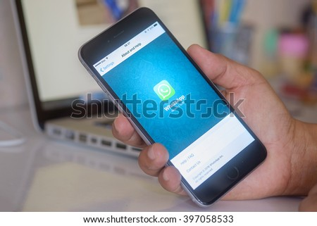 CHIANG MAI,THAILAND - MAR 28, 2016 : Man holding a iPhone 6 plus with social Internet service WhatsApp on the screen. iPhone 6 plus was created and developed by the Apple inc. - stock photo