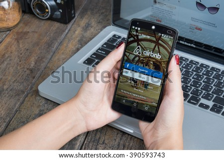 CHIANG MAI, THAILAND -March 12, 2016:LG Nexus 5 open Airbnb application on the screen. Airbnb is a website for people to list, find, and rent lodging. - stock photo