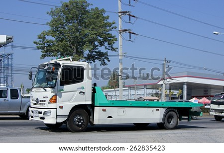 CHIANG MAI, THAILAND - MARCH 5 2015:  Private Slide up tow truck for emergency car move. Photo at road no.1001 about 8 km from downtown Chiangmai, thailand. - stock photo