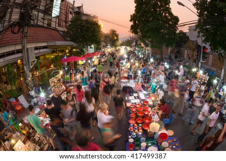 CHIANG MAI THAILAND - MAY 8 : Sunday market walking street, The city center Thai temple marketing and trading of local tourists come to buy souvenirs. on May 8, 2016 in Chiang Mai, Thailand. - stock photo
