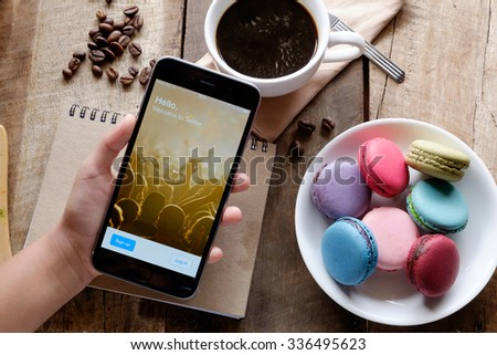 CHIANG MAI ,THAILAND - NOV 08, 2015: A man trying to log in Twitter application using Apple iPhone 6. Twitter is largest and most popular social networking site in the world. - stock photo