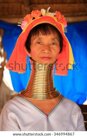 Chiang Mai, Thailand - Nov 27, 2015: Long neck lady. Kayan Lahwi tribe known for wearing neck rings, brass coils to extend the neck.call is long neck karen. - stock photo