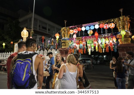 CHIANG MAI THAILAND - NOVEMBER 25 : Loy Krathong festival. Unidentified tourists walked to booking area to watch the parade Loy Krathong Festival. on November 25, 2015 in Chiang Mai, Thailand. - stock photo