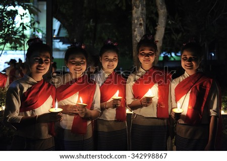 CHIANG MAI THAILAND - NOVEMBER 23 : Loy Krathong festival. Unidentified women dressed in traditional candle lighting ceremony to worship. on November 23, 2015 in Chiang Mai, Thailand. - stock photo
